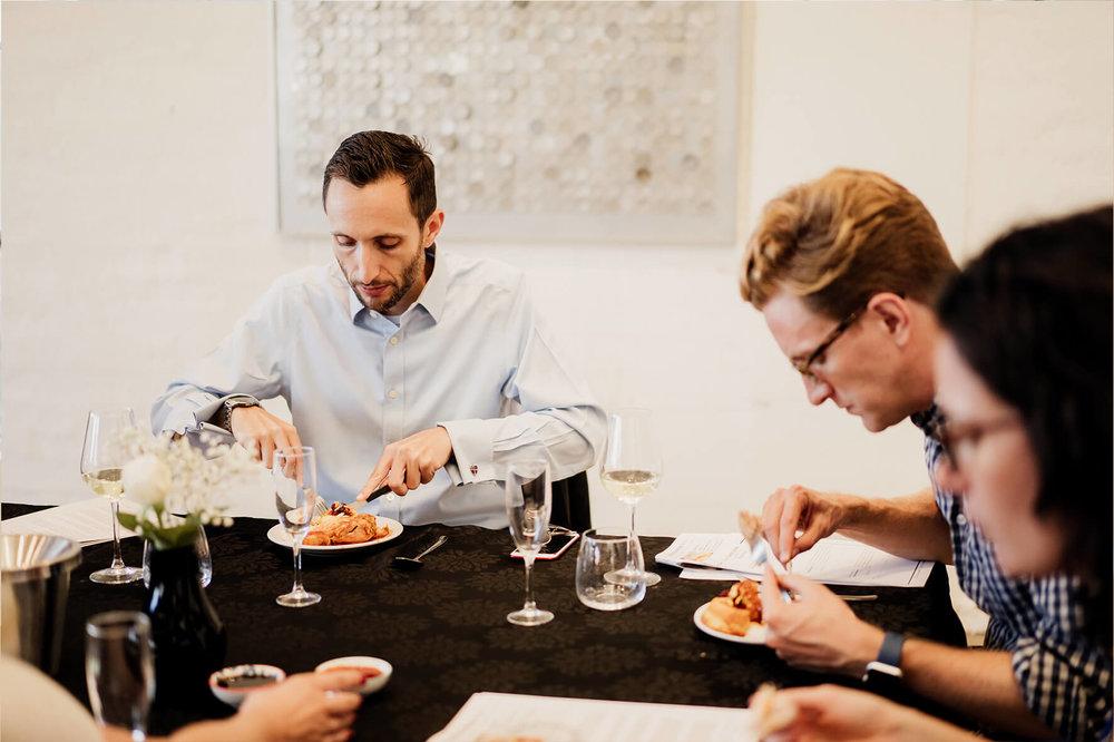 AmazingCo Refugee Degustation - Guests enjoying Somayeh's dish.jpg