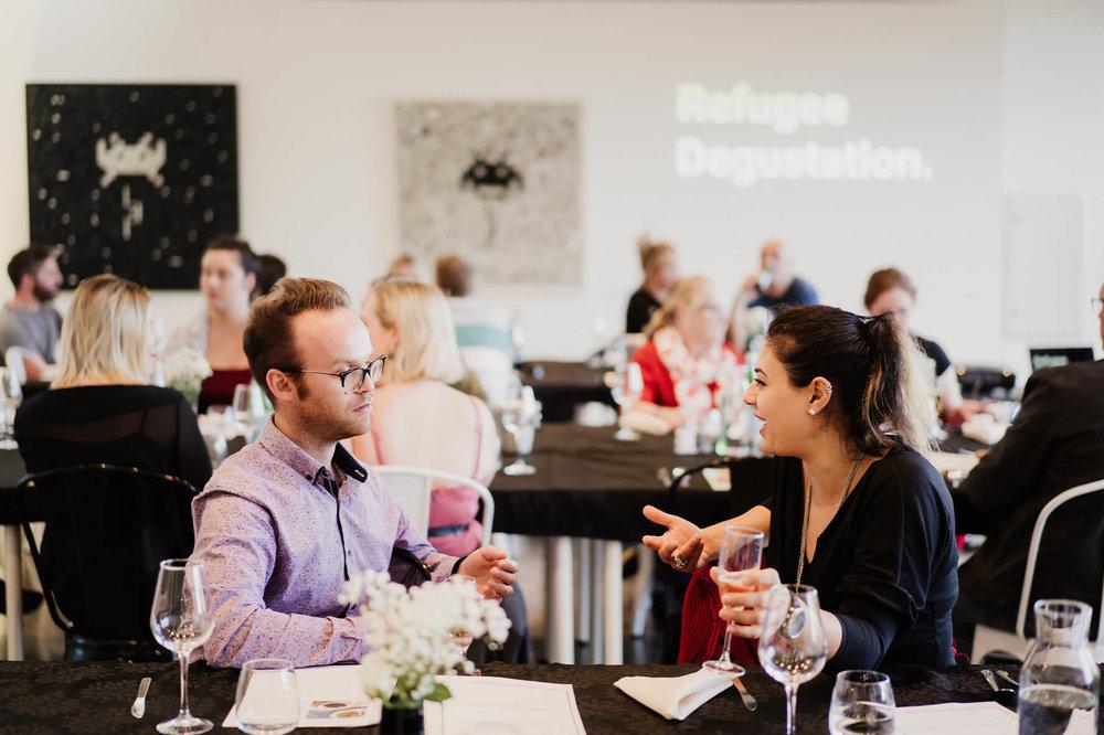 AmazingCo Refugee Degustation - Guests in conversation between meals.jpg