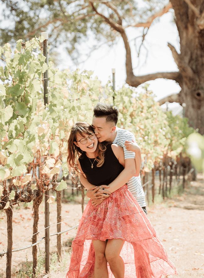Zach and Gina among the vines.png