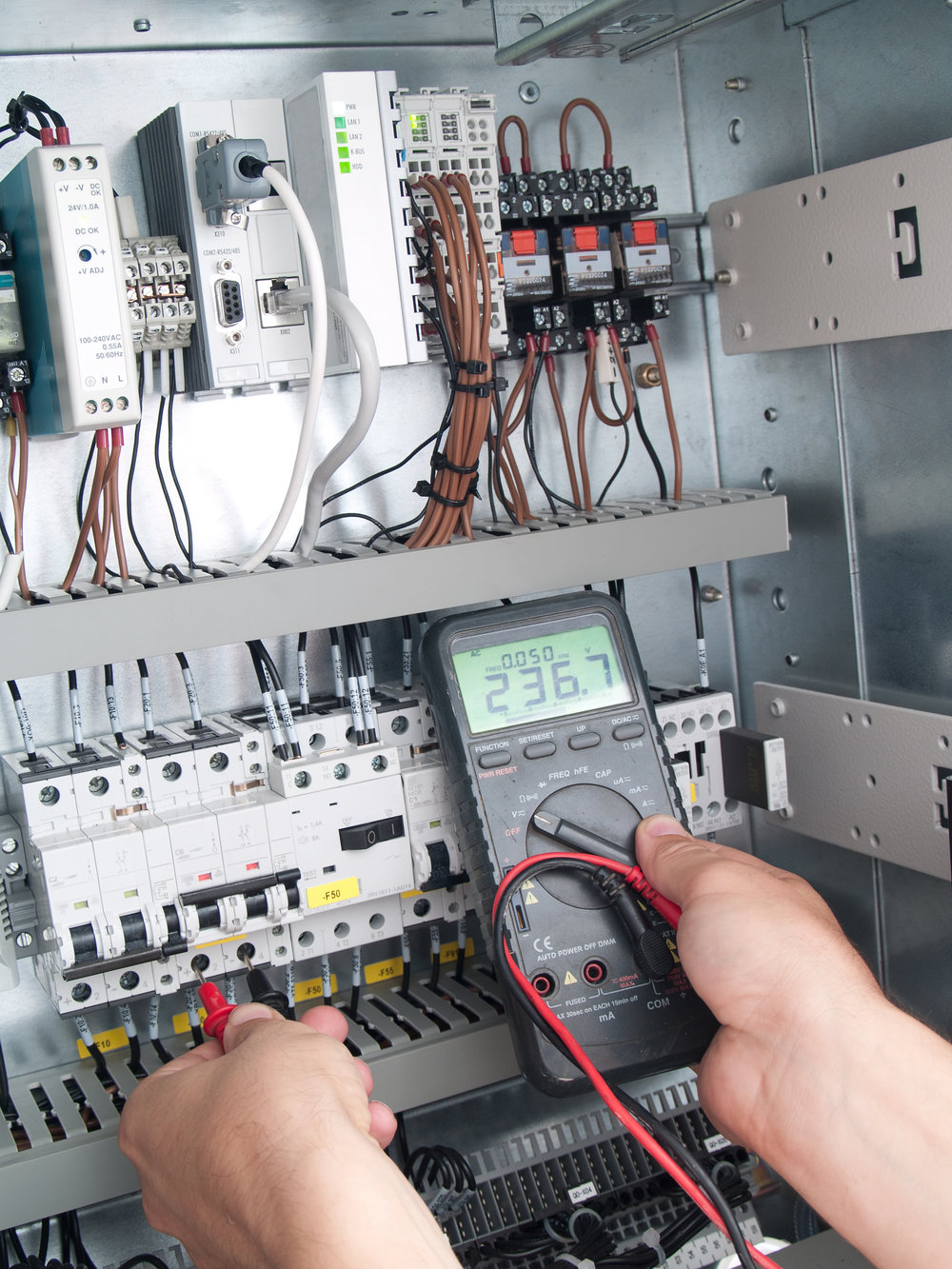 Engineer makes maintenance of power network automation