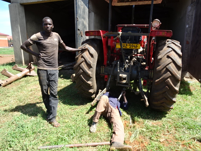 Kilama Patrick with the tractor DO! bought in 2016.