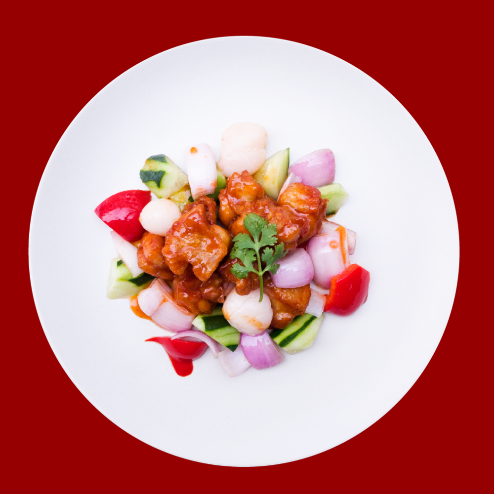 Sweet and Sour Chicken with Lychee  Sautéed crispy chicken with sweet and sour sauce, accompanied with bell peppers, onion, Japanese cucumber and lychee. RM 20
