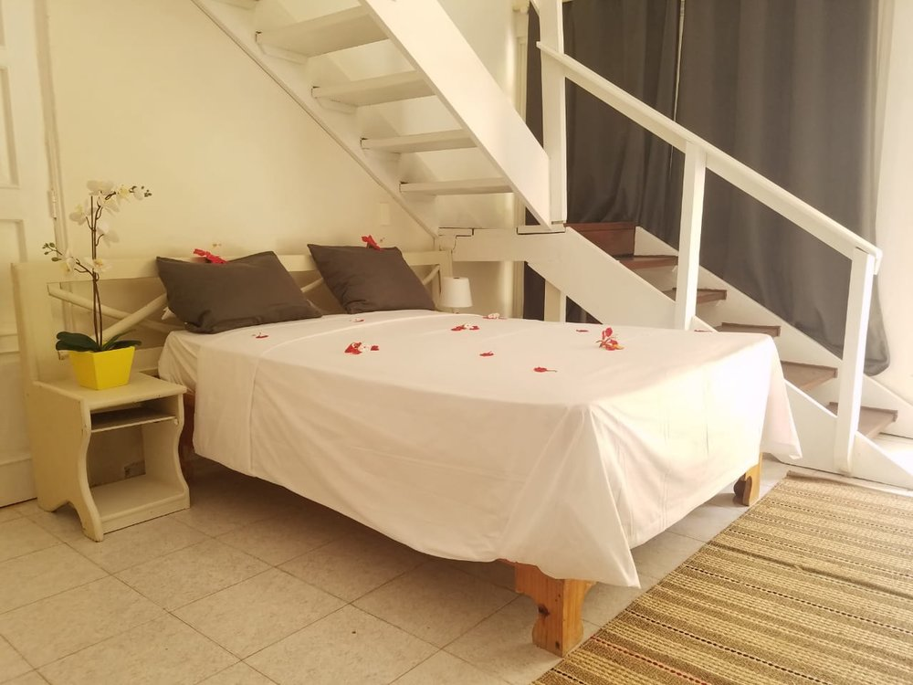 STANDARD & PRIVATE - Perfect for couples or friends, this 2 levels room with 2 double beds that can host up to 4 people features air conditioning, cable TV,  showers, toiletries and a small terrace Starting at: US$ 30