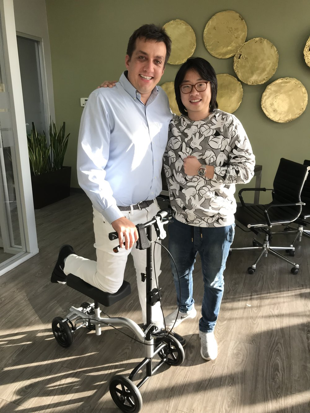 Eric Wind with Jimmy O. Yang at Bob's Watches in Huntington Beach, California in November 2017. Eric was recovering from a broken foot at the time.