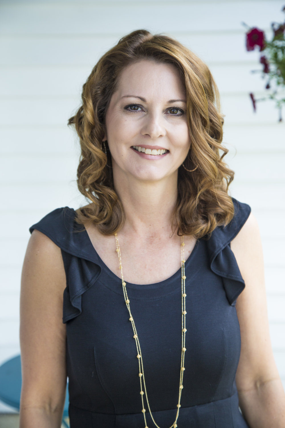 Kim Fox, Owner and Lead Coordinator of Thee Draper Village Wedding & Events Company