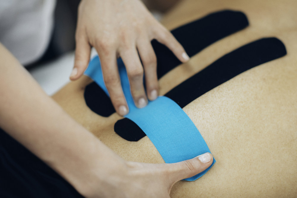 Kinesio Taping - Kinesio tape, a brand of sports tape, alleviates discomfort and facilitates lymphatic drainage by microscopically lifting the skin. This lifting effect increases interstitial space allowing for a decrease in inflammation, and reducing pressure while enabling a more effective flow of blood and lymphatic fluid in and out of the target area. It can be applied in hundreds of ways, and has the ability to re-educate the neuromuscular system, and prevent injury.