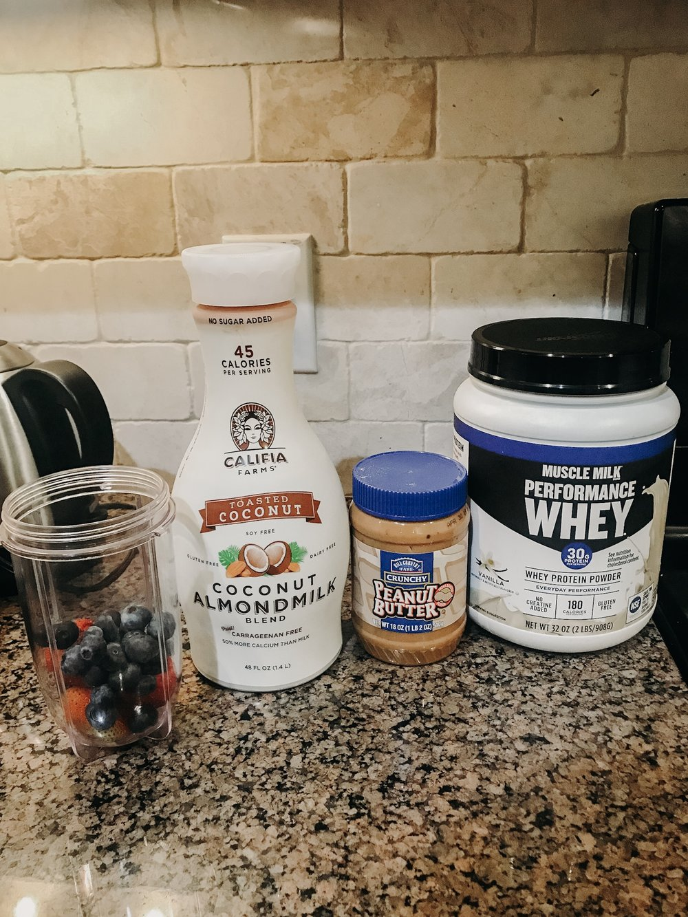 pb & j protein smoothie - + handful of strawberries and blueberries+ coconut almond milk+ peanut butter [or almond butter]+ vanilla whey protein