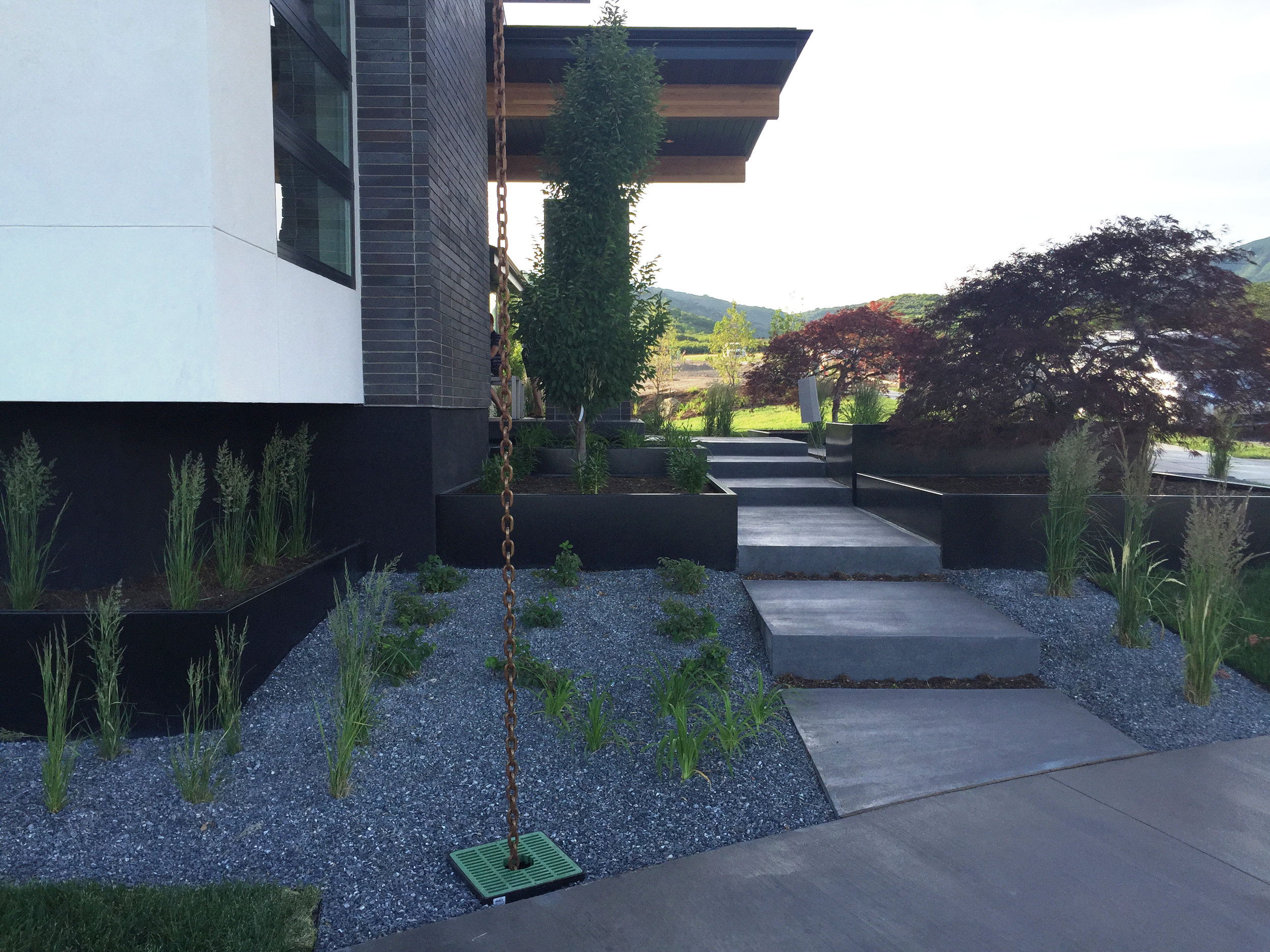 Modern landscaping details with metal flower beds in this Parade of Homes house tour on Happy Confetti Design