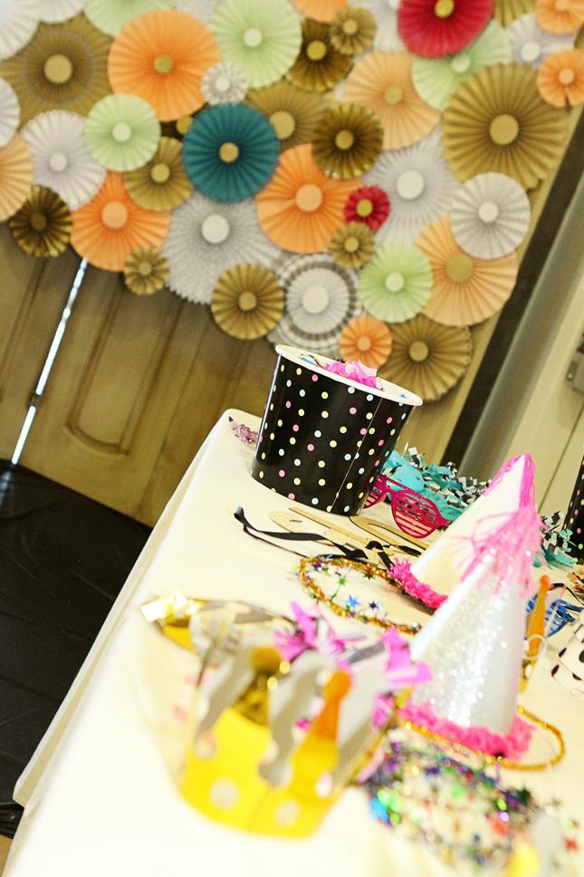Have a confetti photo booth at a confetti party. Blow confetti into the camera!
