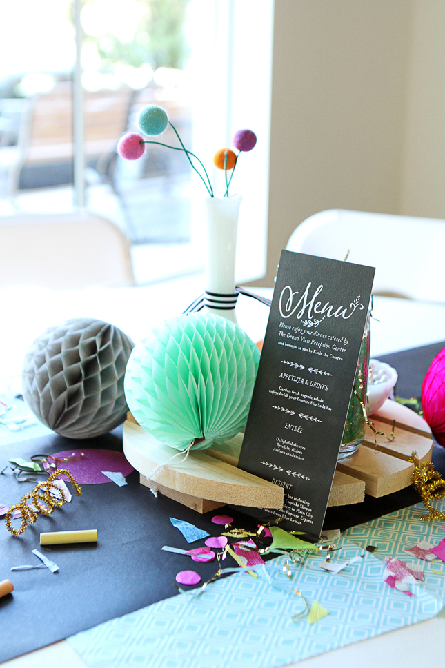 Such a fun confetti party table with felt balls in milk vases and honeycomb tissue balls.