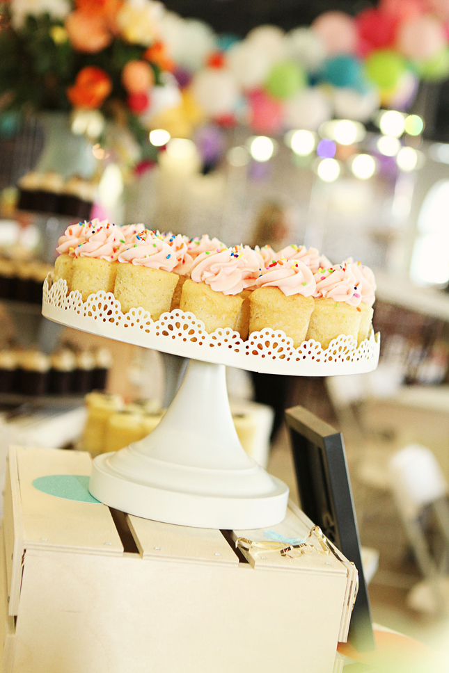 Cute pink sprinkled cupcakes at a confetti party!