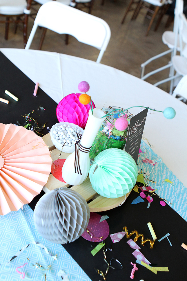 Handmade confetti and honeycomb tissue balls on tables at this awesome confetti party!