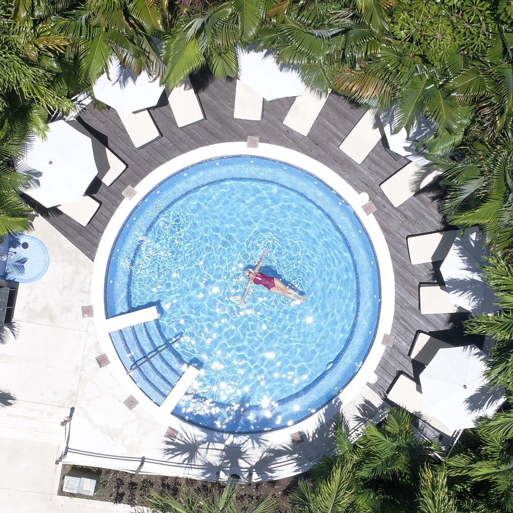 drone shot of floating in pool