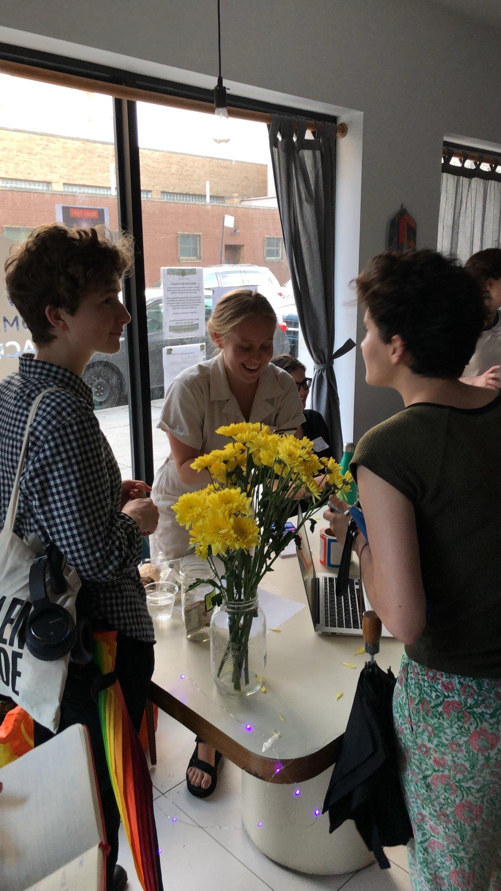me signing in w flowers.JPG
