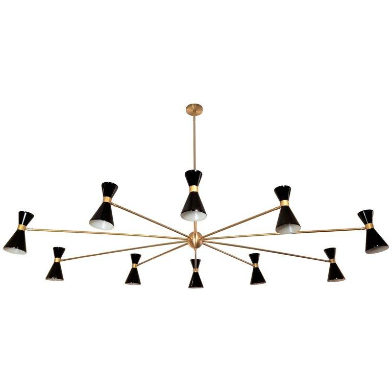 Campana Chandelier - $9200.00As Shown: Black & Natural Brass. Dimensions can be customized to fit your needs.