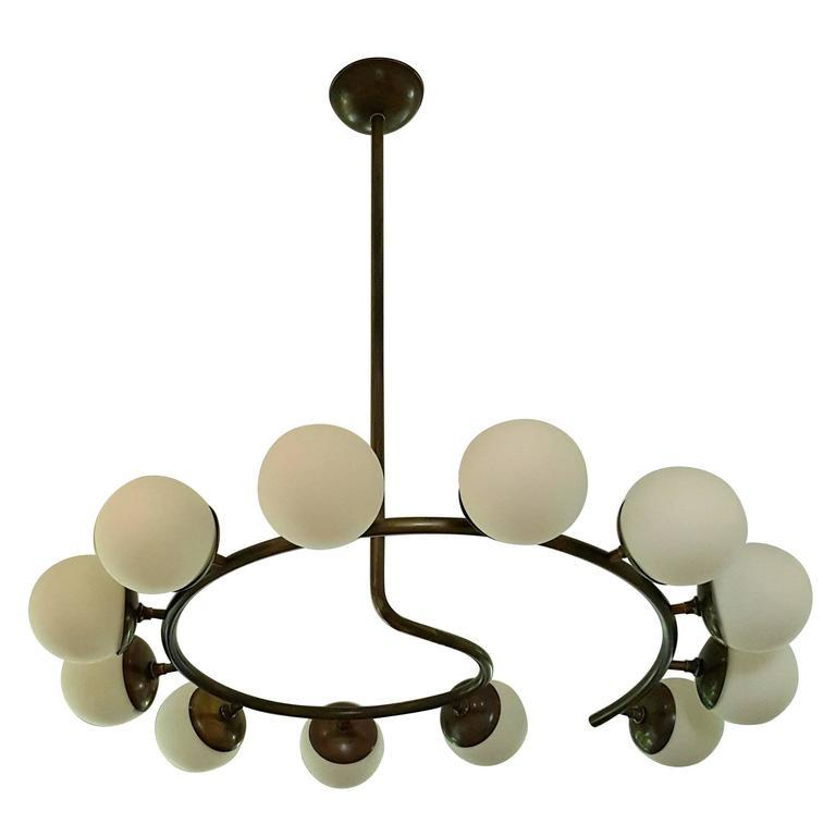 Fibonacci - $8800.00As Shown: Frosted Globes and Oil Rubbed Bronze. Available in enamel and clear globes. Dimensions are customize able along with the amount of globes.