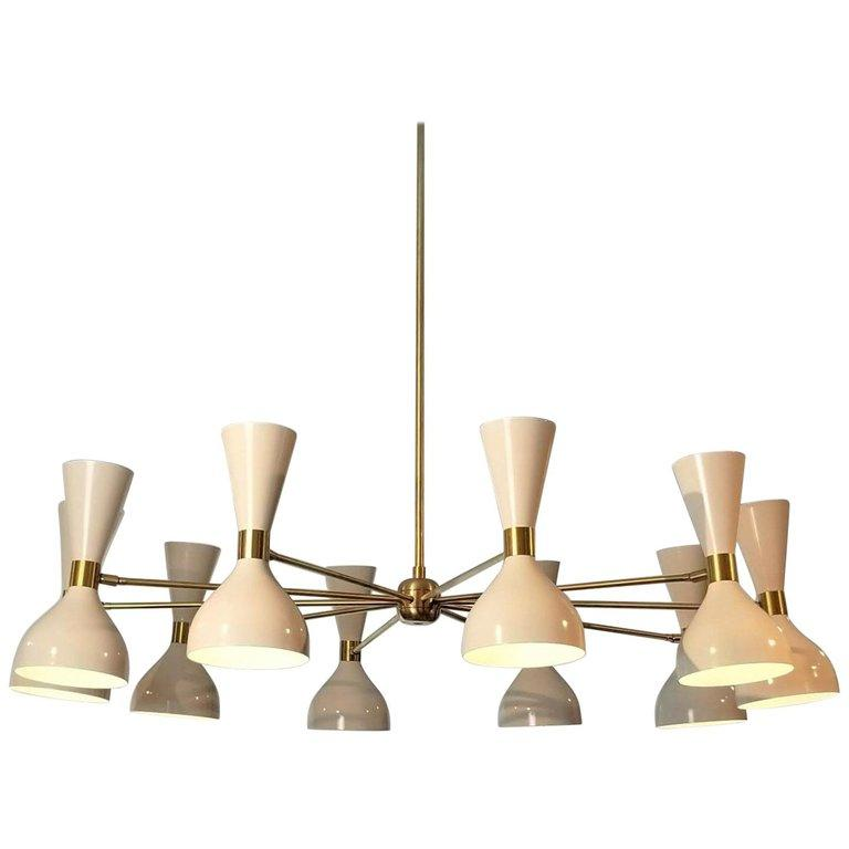 Ludo Chandelier - $6400.00As Shown: Perfect White & Natural Brass.