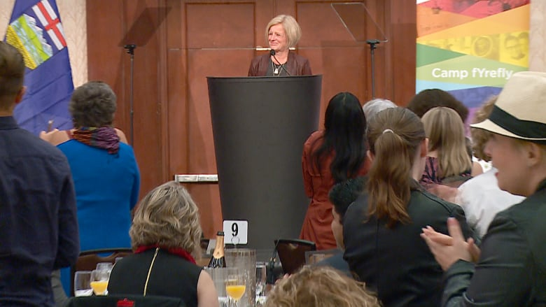 Alberta Premier Rachel Notley receives a standing ovation as she announces coverage for an HIV-prevention drug during Calgary Pride. (Terri Trembath/CBC)