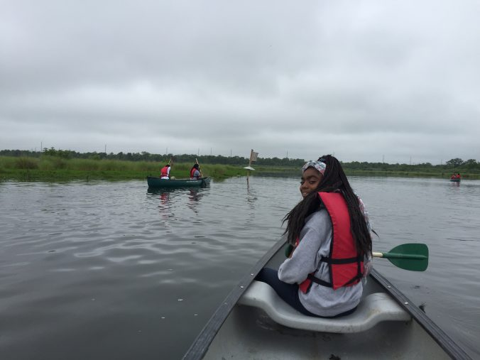 Students explore the wetlands by canoe.