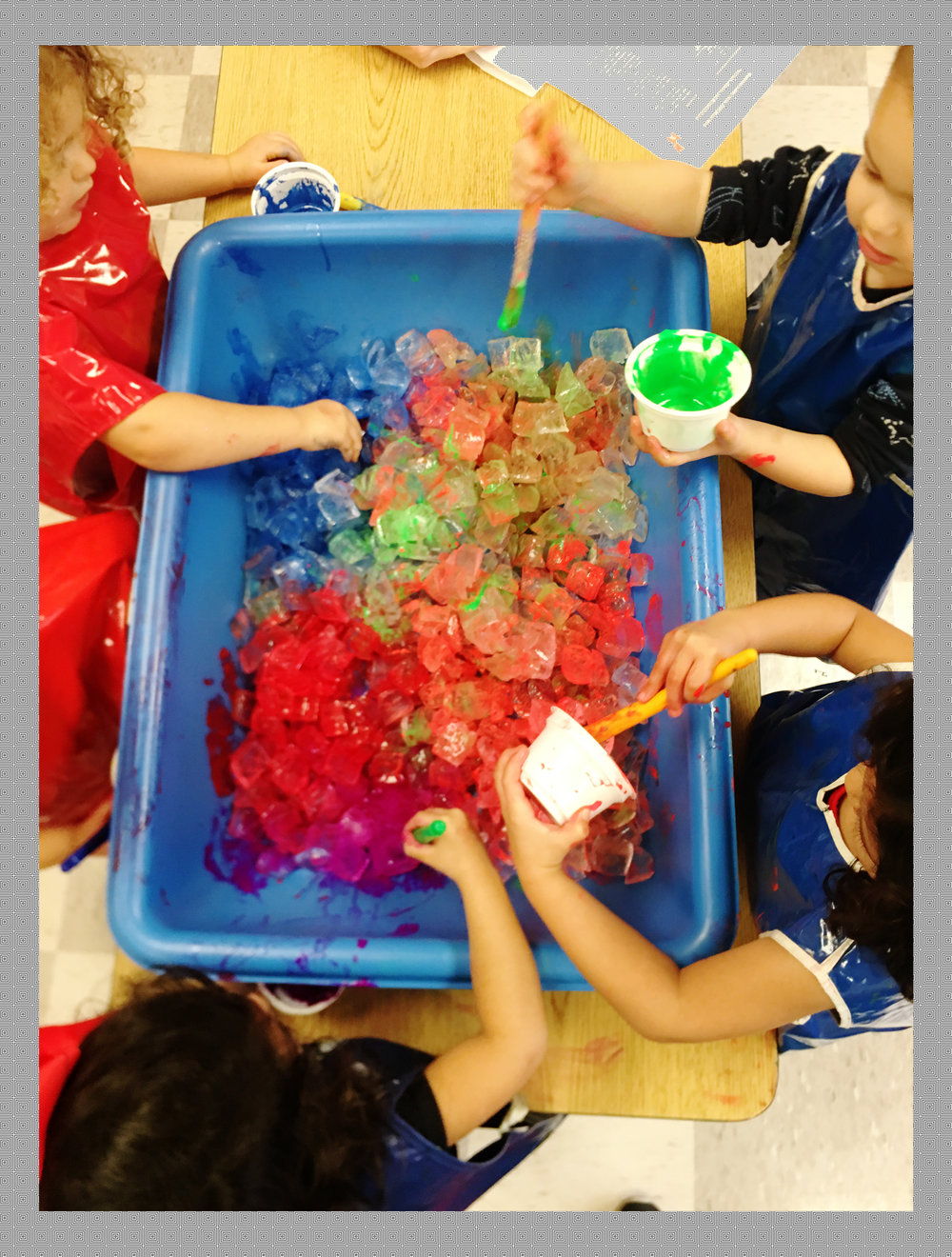 "three-year-olds learn about mixing primary colors While painting ice - ""When I paint, I am learning about shape, line, and color. I am learning fine motor control from holding a paintbrush and applying the right amount of pressure onto the ice cubes. I am learning to be calm and focused while others play around me."""