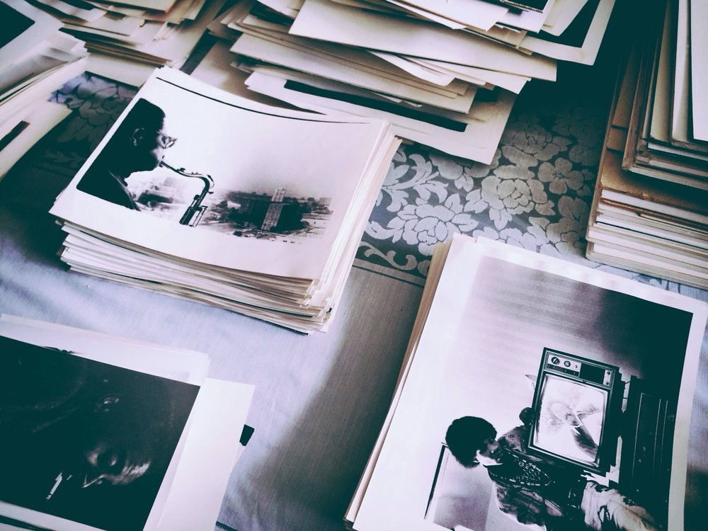 Mid-cataloguing Herb Nolan's photography collection. His work is organized into three categories: Music, Travel, and Chicago/Family & Friends.