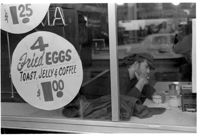 Tom Waits at the Victoria Restaurant , silver gelatin print by Herb Nolan, 1976
