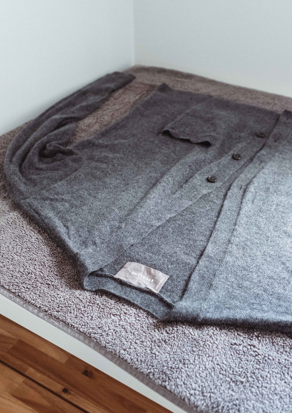 Step 9:  finally, reshape your sweater again and lay it out on the towel to dry