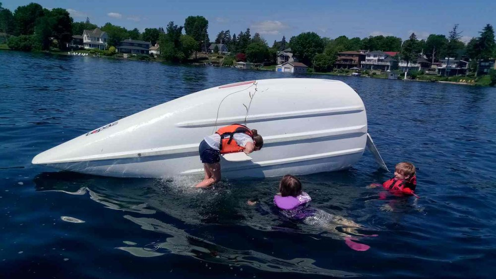 Brockville Yacht Club Sailing School summer swimming fun on centerboard.jpg