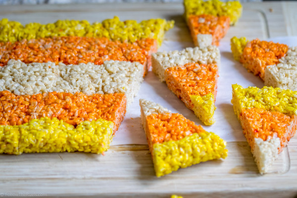 Triangle rice krispie treats in orange, yellow, and, and white.