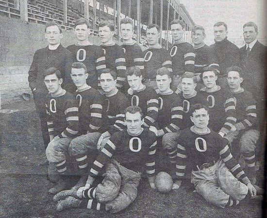 1912 Garnet and Grey varsity football team. Coached by Father William Stanton (top left).