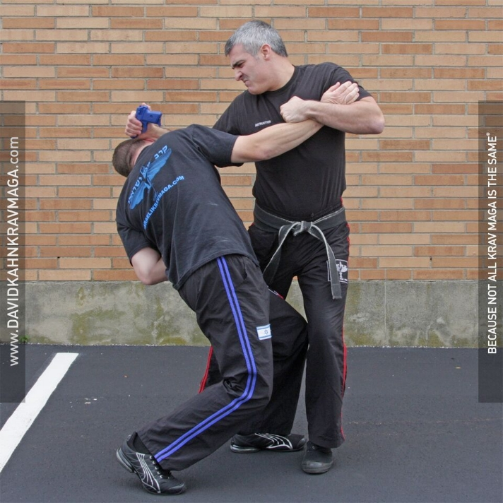 5.22g Handgun Defense from the Rear When the Assailant is Controlling:Choking You with His Free Arm.JPG