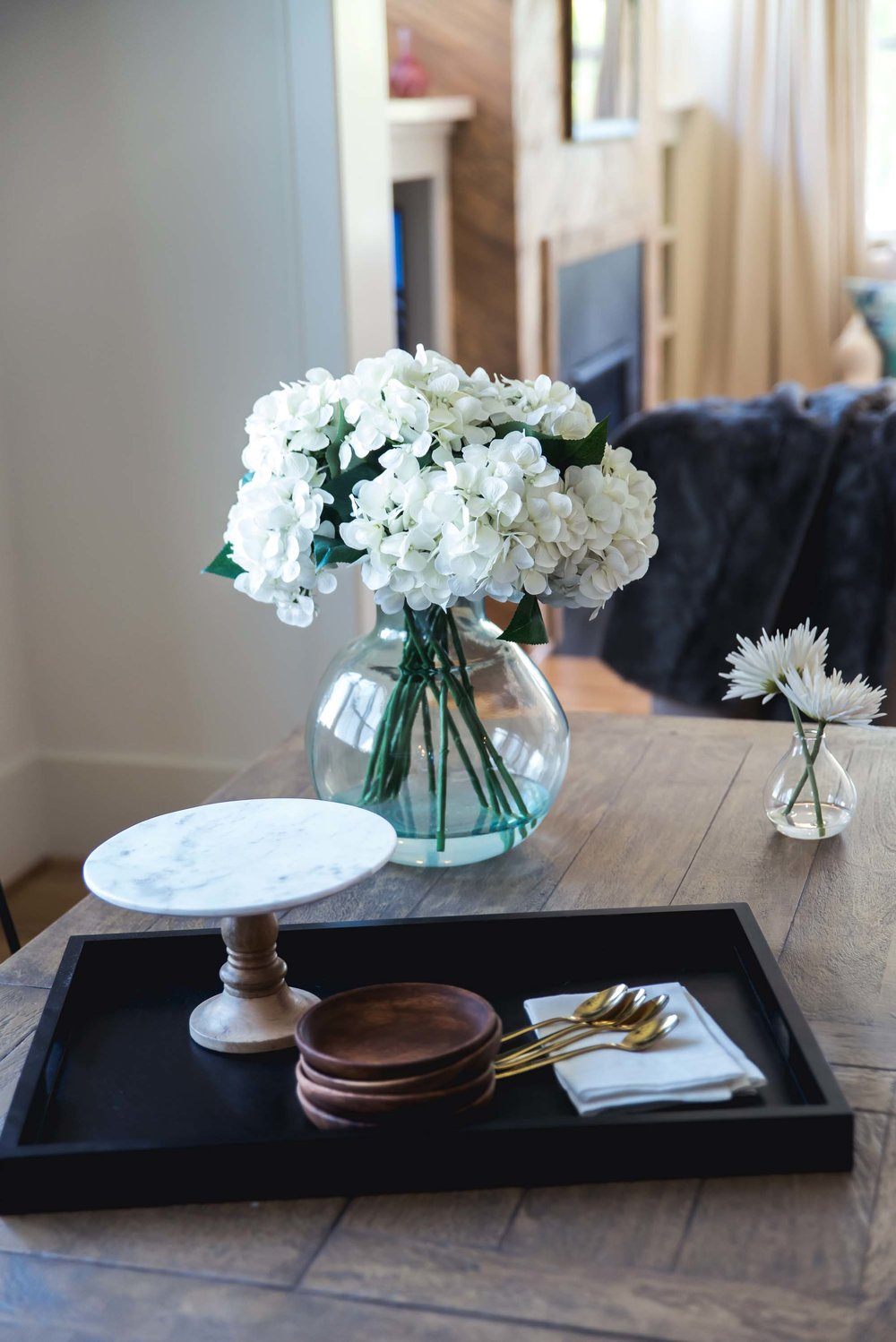 1. Wooden table with wooden serving tray and flower vase