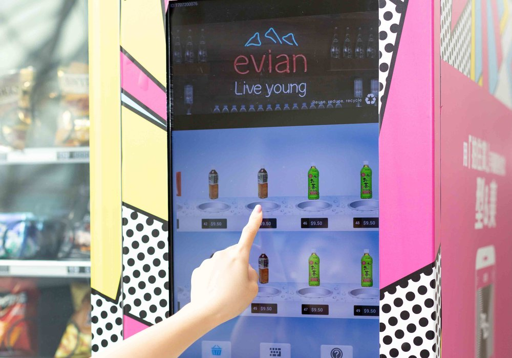 EVIAN - Evian is a brand of premium mineral water sourced from the French Alps, and is mostly targeted at consumers with higher discretionary incomes. In addition to stocking its products in our machines, Evian was interested in finding new ways to advertise itself through FreshUp. To meet Evian's request, FreshUp was able to develop vending machines that displayed quick 30-second advertisements created by Evian. 60 FreshUp's LCD screen vending machines have been displaying Evian's video ads. These cover corporate offices and banks, e.g. AIA, allowing Evian to effectively show its advertisements directly to its ideal customer demographic.