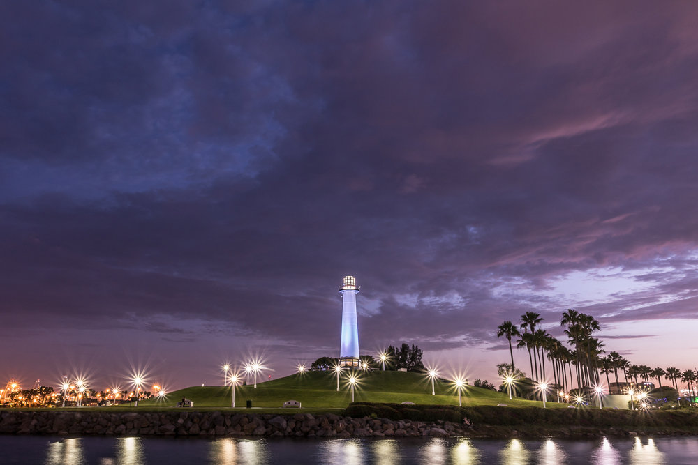 Rainbow Harbor Lighthouse. The lights of the Port of Long Beach are visible on the left.
