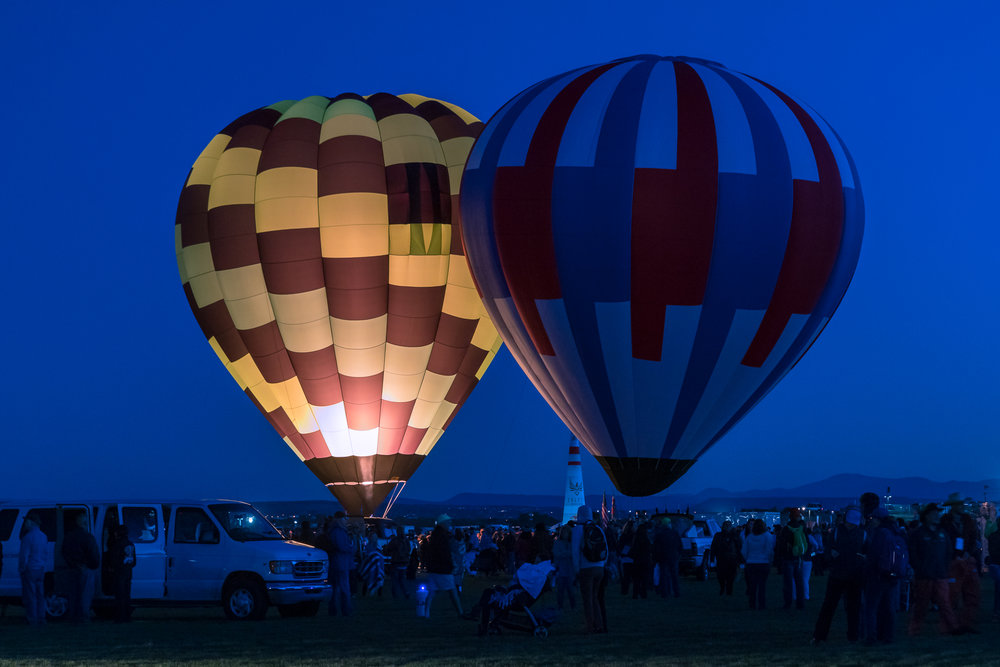 During Dawn Patrol, a small number of balloons inflate and take off early in the morning before everyone else. These balloons appear like floating Chinese lanterns in the sky.