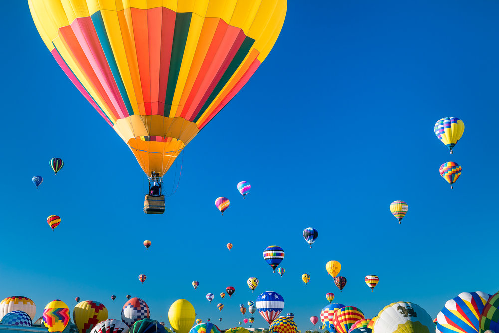 During Mass Ascension, hundreds of balloons take to the skies.