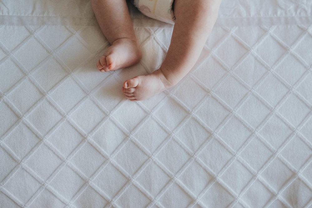 baby-feet-on-diamond-shape-blanket.jpg