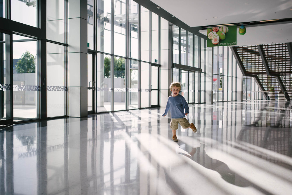 boy-running-in-front-of-a-wall-of-windows.jpg