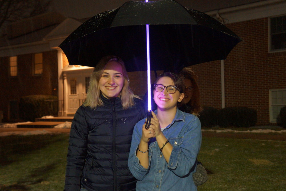 Enjoying the snow with friends and a Jedi umbrella.