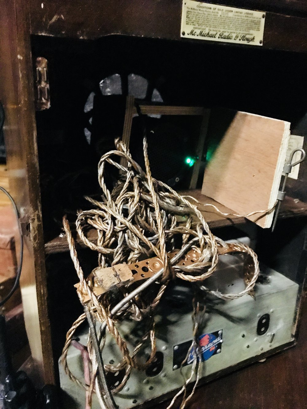 The reassuring green glow of our Minirig 2 peeks out from the bowels of a 1940s Radio cabinet