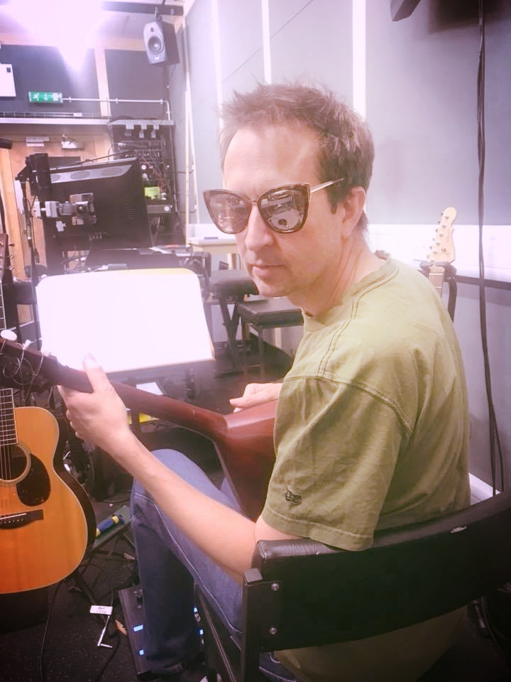 Too cool for his Lute, RSC Guitarist Nick Lee.