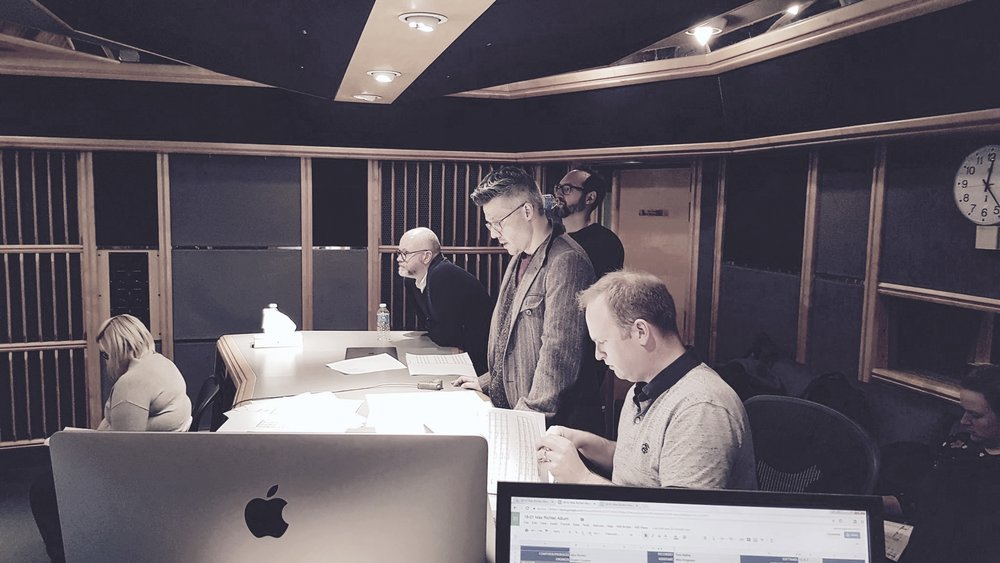 BBC1 - McMafia - Air Studios - Deep in scores for the final session of Series 1 (from right to left - Chris Warner [orchestration & score preparation], Franz Kirmann [composer], Tom Hodge [composer], Paul Ritchie [producer])