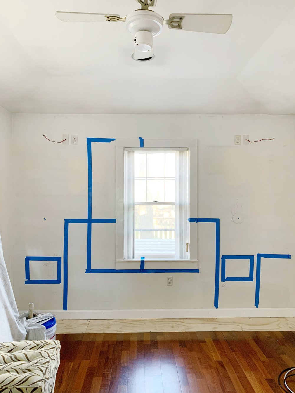 We taped out where the floating night stands will go in relation to the headboard of the bed. This also helped us decide where the sconces should go.