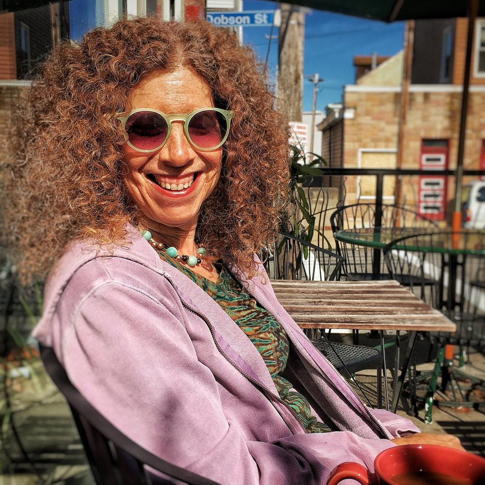 Photographer, artist and educator, Sue Abramson, holding court at a cafe in Polish Hill.