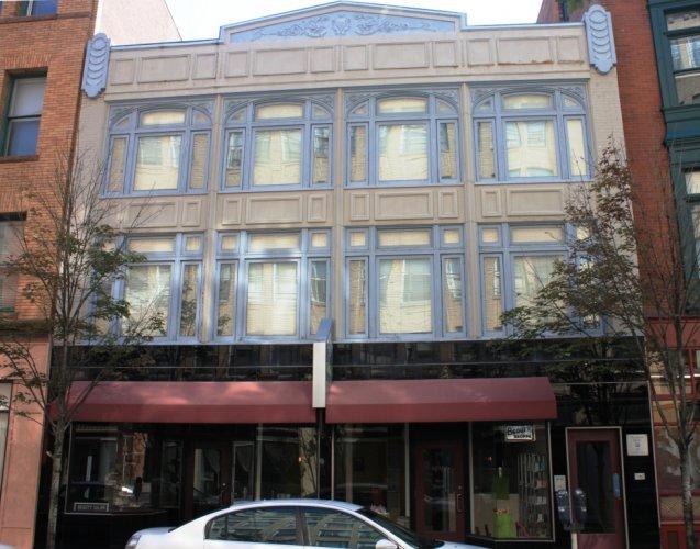 Franklin Building, 53-57 Orange Street, c. 1870; 1927 facade by Brown & Von Baron.