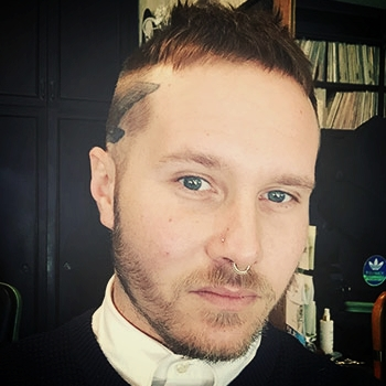 Sean Flynn - Hailing from sunny Miami Beach, Sean has been a Brooklyn resident for the past 11 years. He specializes in fun custom colors, shattered-texture razor cuts, immaculate barber fades, and curly hair of all kinds. He brings a unique and special edge to each service he provides!Book an appointment