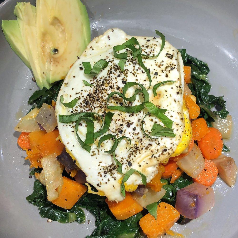 Root veggie hash with organic pastured eggs and avocado.