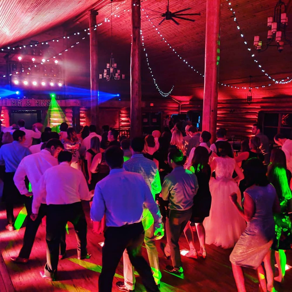 Red uplighting dance floor at Glenhaven Dj Steve Macke Minnesota wedding reception