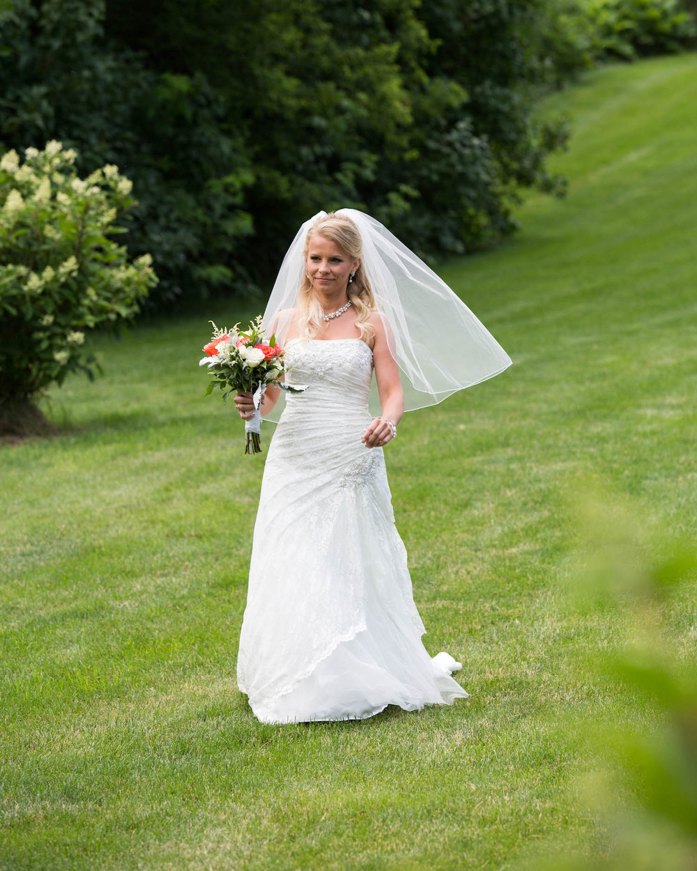 Cindyrellas Garden, outdoor lake ceremony in Minnesota, first look down the hill