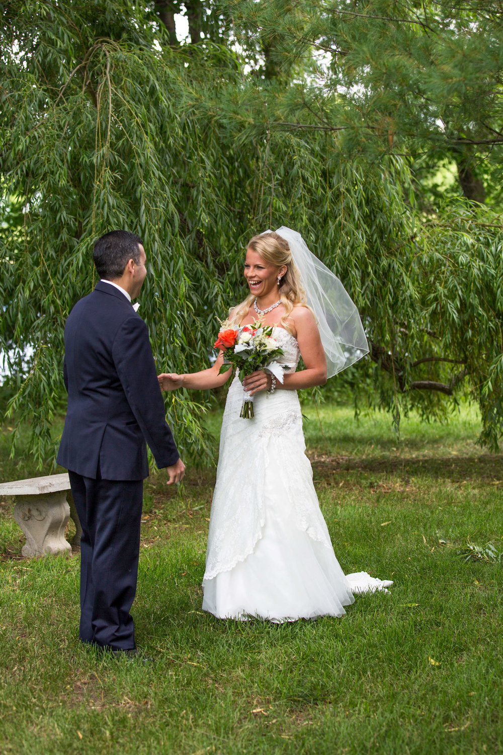 Cindyrellas Garden, outdoor lake ceremony in Minnesota, first look with veil
